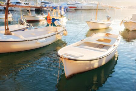 Traditional wooden boats in the sunny morning harbor. Budva, Montenegro