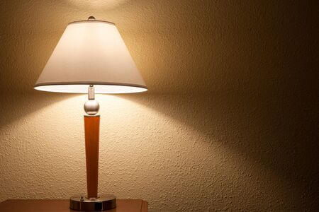 old fashion table lamp over wall background Banco de Imagens