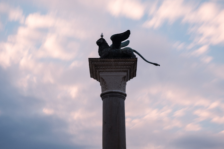 Bronze lion on a column in St. Marks square. Venice. Italy.