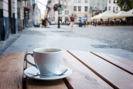 Coffee cup on a table of typical European outdoor cafe