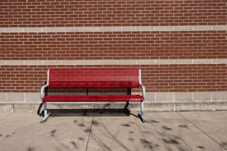 Bench on old town alley over wall background 版權商用圖片