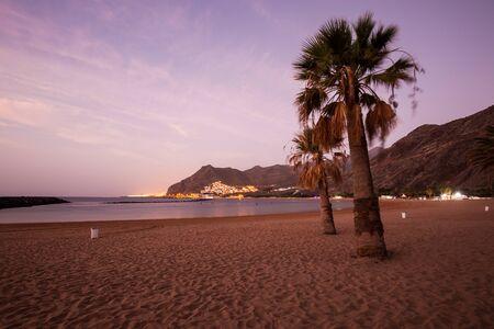 Sunset Clouds and palm trees on Playa de las Teresitas Beach, Tenerife