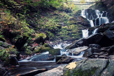 waterfall in deep forest. Cascad creek in mountains 스톡 콘텐츠