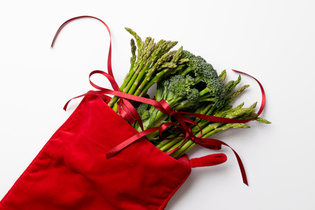 Bunch of green asparagus and broccoli tied with red bow as a healthy gift Stock Photo