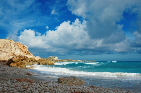 diego: Summer beach - clouds, mountain and waves on remote island Stock Photo