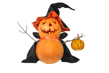 Funny Halloween pumpkin with black hat isolated on white photo
