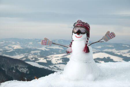 Snowmen at the mountains photo