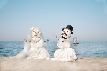 Two Snowmen at the sea photo