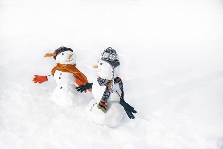 snowmen in love taking hand each other