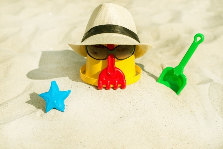 golden shovel: The Beach scene with bucket and sunglasses