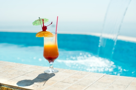 Cocktail in the swimming pool at the sea photo