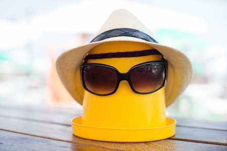 golden shovel: The Beach scene with bucket, hat and sunglasses