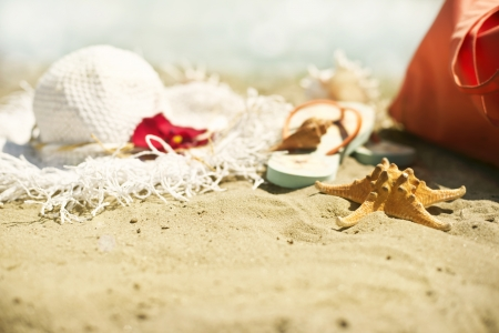 pensacola: Collection of beach items - seastar, flip-flops, sunglasses and hat Stock Photo