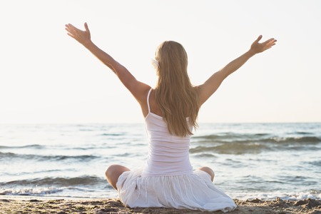 Young blonde woman meditation on the beach Archivio Fotografico