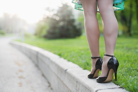 Woman legs and high heels in the park Stock Photo