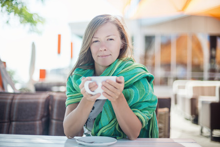 Happy Woman holding a cup of coffee photo
