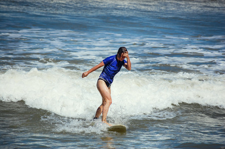 young woman surfing photo