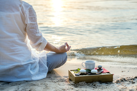 meditate: Woman meditating Stock Photo