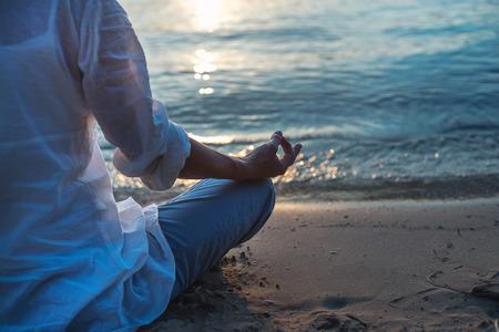 sexual position: Woman meditating Stock Photo