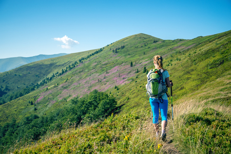 Young woman hiking in the mountains photo