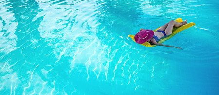 Young woman enjoying a swimming pool Archivio Fotografico
