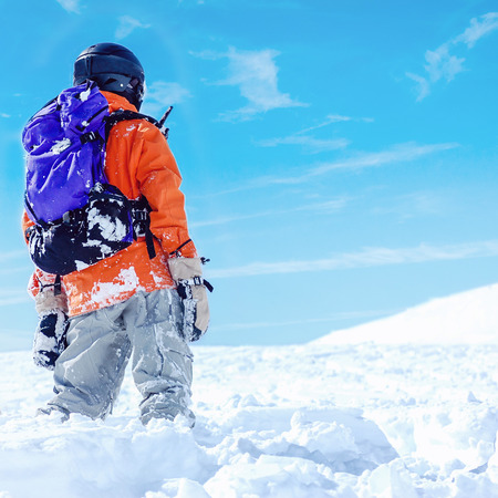 people in action: Snowboard freerider  in the mountains