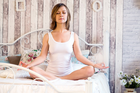 Woman doing yoga at home.