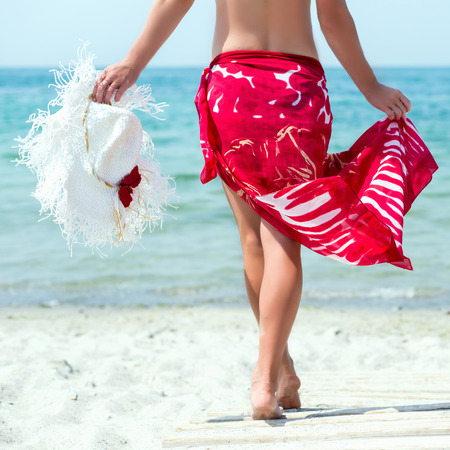 Woman walks at the beach Stock Photo