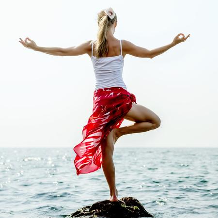 composure: Woman meditating at the sea