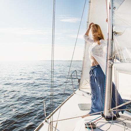 staying: woman staying on sailboat