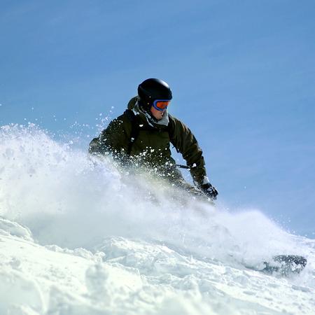 deep powder snow: Snowboarder in deep powder