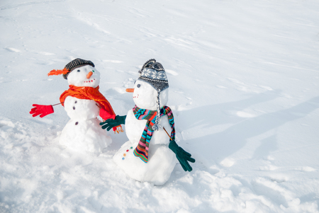 yard stick: Couple of snowmen looking at each other