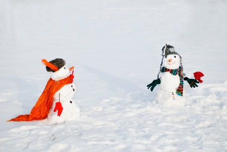 Couple of snowmen looking at each other