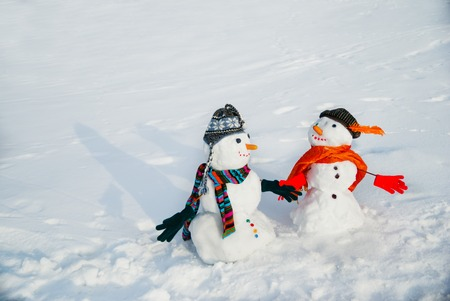 christmas fun: Couple of snowmen looking at each other