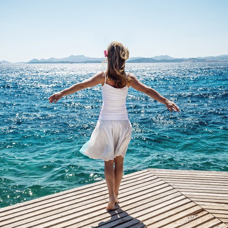 incubus: Beautiful blonde girl standing at the sea Stock Photo