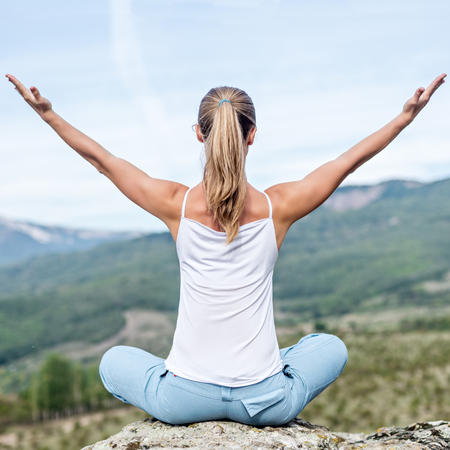 yoga rocks: Blonde Woman Doing Yoga at the Mountains