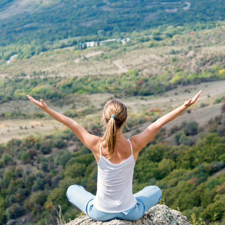 meditation woman: Blonde Woman Doing Yoga at the Mountains