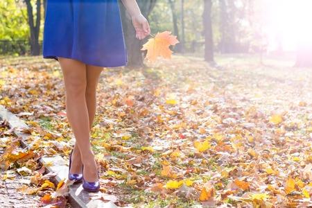 woman legs in high heels walking in the park Archivio Fotografico