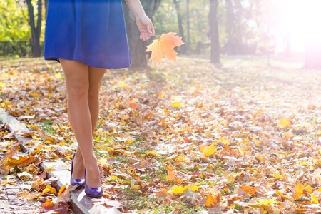 woman legs in high heels walking in the park Stock Photo