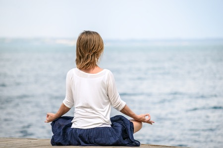 composure: serenity and yoga practicing at the sea