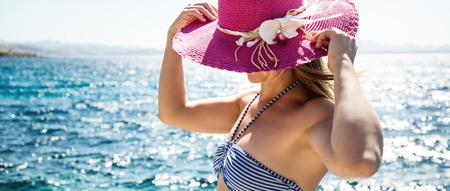 ankles sexy: Beautiful woman with hat at the beach Stock Photo