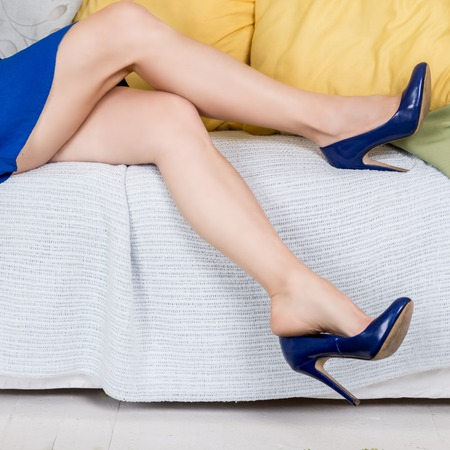 woman couch: Beautiful luxurious woman sitting on a vintage couch