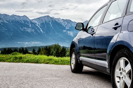 car for traveling with a mountain road Stock Photo