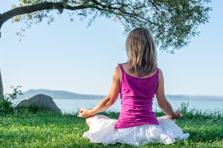 serenity and yoga practicing at the lake Balaton Stock Photo