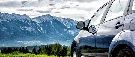 car for traveling with a mountain road 写真素材
