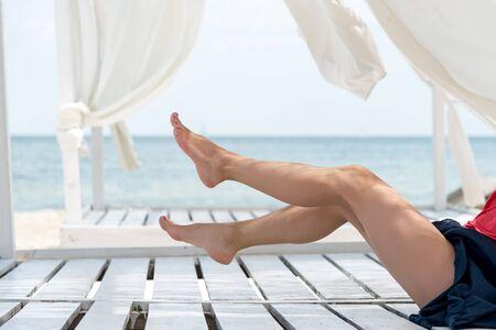 suntanned: Womans beautiful legs on the beach Stock Photo