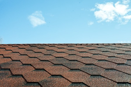 Tile roofs, patterns of the blue sky Archivio Fotografico