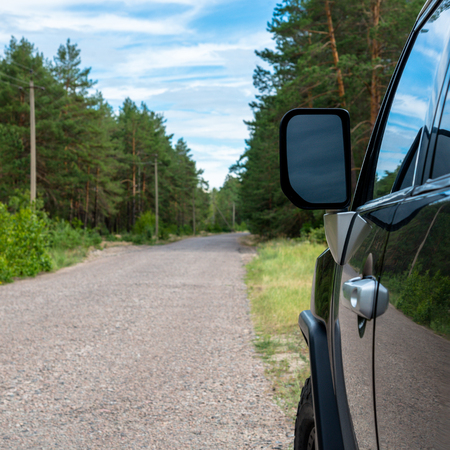 the arable land: Car in the forest road