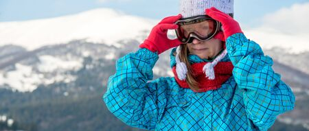 Portraite of sport woman in snowy mountains