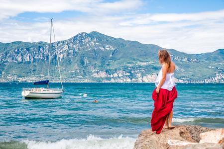 Woman meditating at the lake Archivio Fotografico